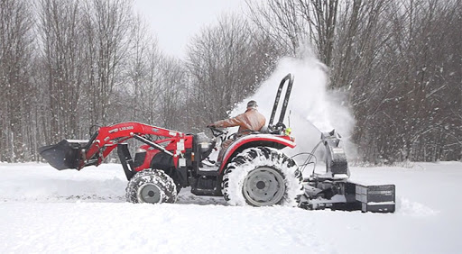 A Beginner's Guide to Snow Plowing With a Skid Steer
